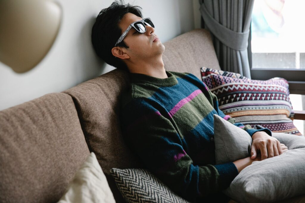 photo of man resting on couch