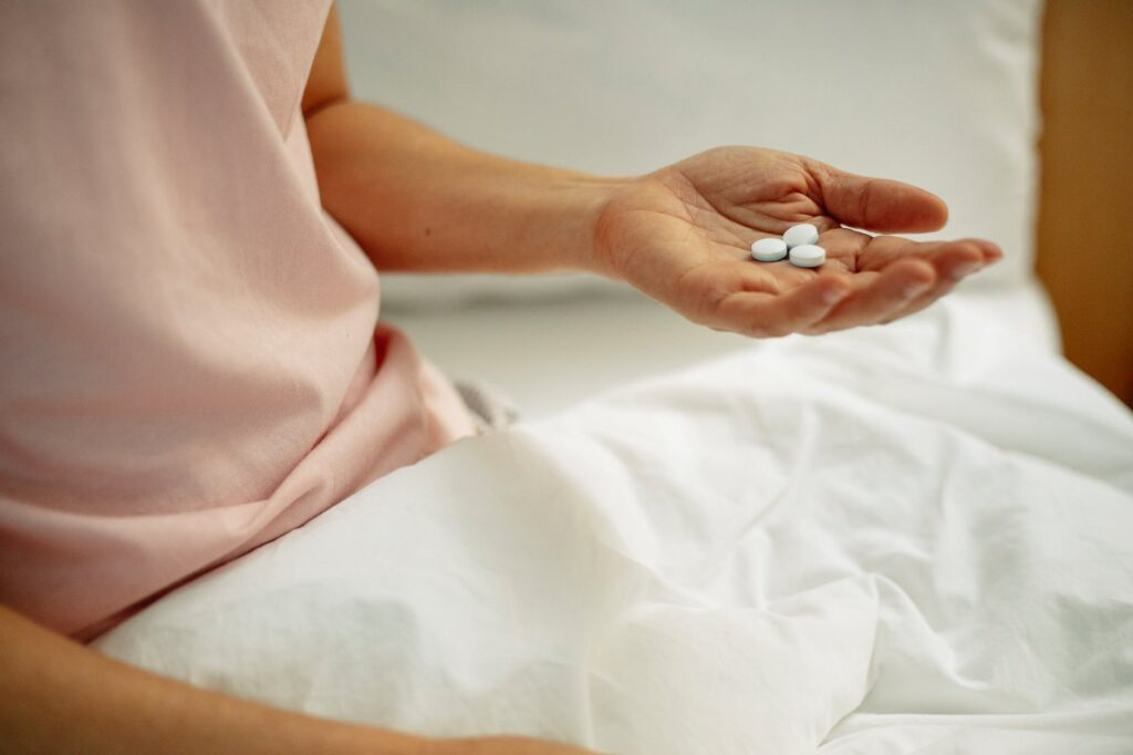 woman preparing for taking painkiller in hand